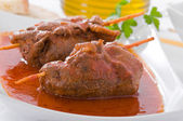 Meat roulade on white dish. — Stock Photo