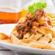 Tagliatelle with Bolognese Sauce. - Stock Photo