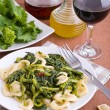 Orecchiette with turnip tops. — Stock Photo