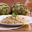 Risotto with artichokes. Risotto ai carciofi. - Stock Photo