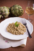Risotto with artichokes. — Stock Photo