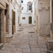 Alleyway. Cisternino. Puglia. Italy. - Stock Photo