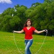 Young woman with skipping rope — Stock Photo