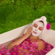 Stock Photo: Beautiful womenjoying floral bath