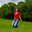 Stock Photo: Young woman with skipping rope