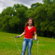 Young woman with skipping rope — Foto Stock