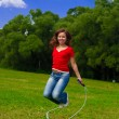 Royalty-Free Stock Photo: Young woman with skipping rope