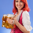 Oktoberfest waitress holding beer — Stock Photo
