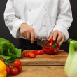 Chef chopping vegetables — Stok fotoğraf