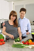 Young couple preparing salad — Stock Photo