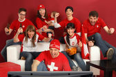 Excited Swiss sports fans — Stock Photo