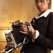 Beautiful female holding antique camera — Stock Photo