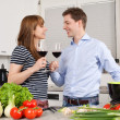 Stock Photo: Young couple drinking wine in the kitchen