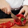 Chopping bell pepper — Stock Photo