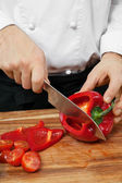 Chopping bell pepper — Stock Photo