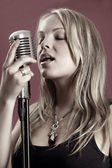 Gorgeous singer and vintage microphone — Stock Photo