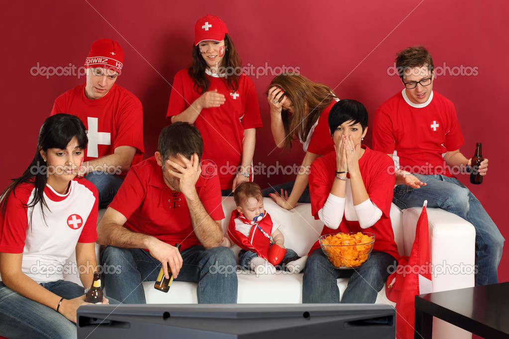 Photo of Swiss sports fans watching television and being disappointed with the game. — Stock Photo #10690732