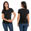 Woman standing with blank black shirt — Stock Photo #8003750