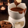 Dipping into chocolate fondue — Stock Photo