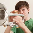 Teen playing silver trumpet — Stock Photo