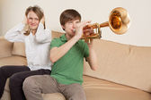 Annoying trumpet player — Stock Photo