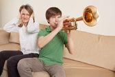 Annoying trumpet player — Stock Photo