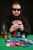 Poker player wearing sunglasses — Stock Photo