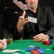 Card player throwing in his hand — Foto Stock