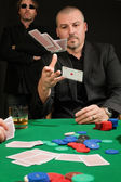 Card player throwing in his hand — Stock Photo
