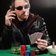 Stock Photo: Smoking gambler