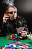 Smoking gambler — Stock Photo