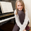 Stock Photo: Young girl and her piano
