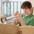 Male teenager playing the trumpet — Stock Photo #8888727