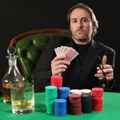 Professional poker player — Stock Photo
