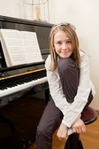 Young girl and her piano — Stock Photo
