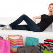 Happy shopper surrounded with bags — Stock Photo