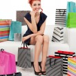 Beautiful woman surrounded with bags — Stock Photo