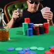 Stock Photo: Serious poker player wearing sunglasses