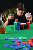 Serious poker player wearing sunglasses — Stock Photo
