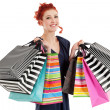 Beautiful woman holding colorful bags — Stock Photo