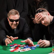 Winning and losing card players — Stock Photo
