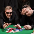 Stock Photo: Winning and losing card players