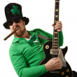 Leprechaun playing the guitar — Stock Photo #9084376