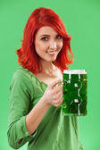 Redhead drinking green beer — Stock Photo