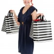 Happy shopper showing her bags — Stock Photo