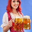 Beautiful woman serving beer at Oktoberfest — Stock Photo