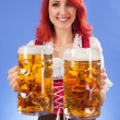 Stock Photo: Oktoberfest girl serving beer