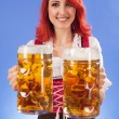 Oktoberfest girl serving beer — Stock Photo