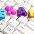 Exam word made by colorful letters — Stock Photo