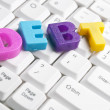 Debt word made by colorful letters — Stock Photo